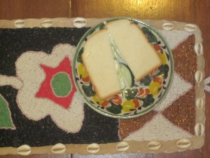 """Cucumber sandwich on african beaded runner"