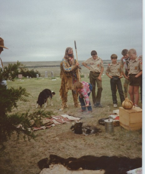 Ken Widener showing tanned hides to Boy Scout, Lutheran Stone School 15 miles south of Meade Kansas. Folk Arts Festival at the Stone School, summer 1989.