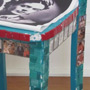 A chair with mosaic tiles, picture tiles featuring images of Frida Kahlo and her paintings